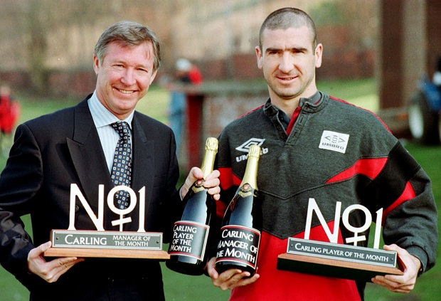 File photo dated 04/04/1996 of Manchester United's Alex Ferguson and Eric Cantona celebrating in Manchester after winning the Carling's Manager of the Month and Player of the Month respectively. PRESS ASSOCITAION Photo. Issue date: Wednesday May 8, 2013. Sir Alex Ferguson will retire at the end of this season, Manchester United have announced. See PA Story SOCCER Man Utd. Photo credit should read: Peter Wilcox/PA Wire.